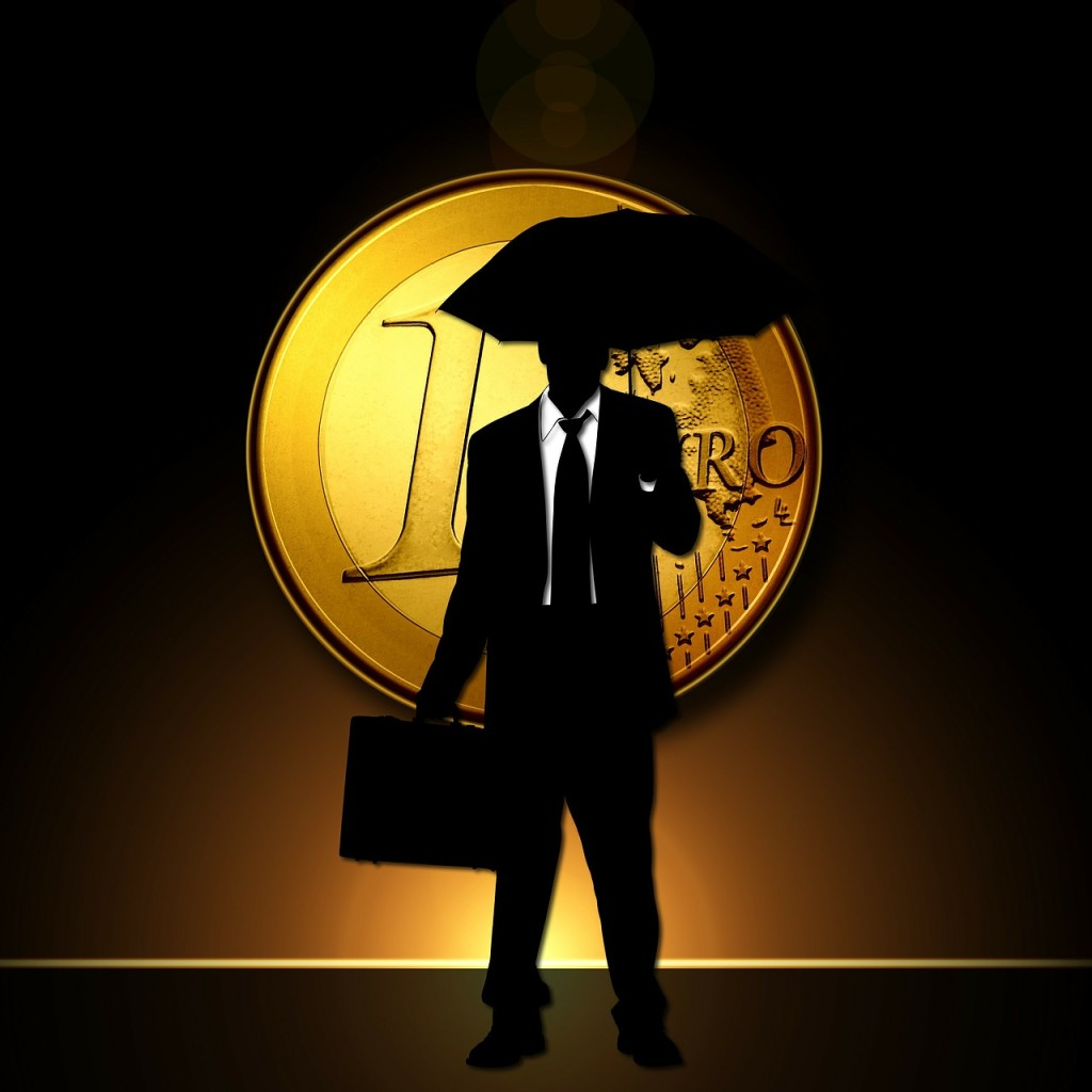 euro-Im Regen mit Schirm